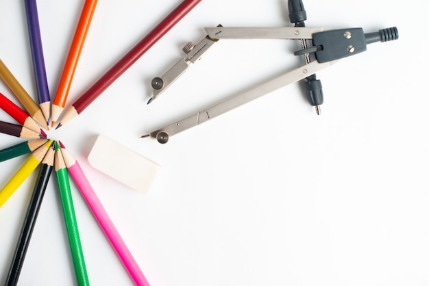 School supplies and colorful pencils on white Premium Photo