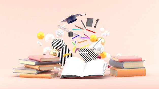 School supplies floating out of a book amidst colorful balls on soft pink. 3d render Premium Photo