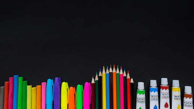 School supplies mockup on blackboard background with copyspace Premium Photo