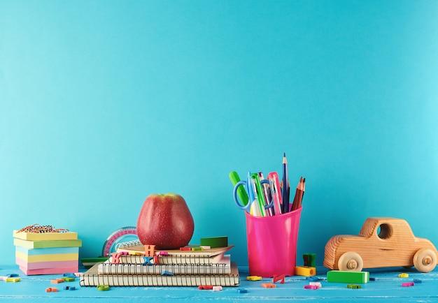 School supplies: notebook, pencils, stickers Premium Photo
