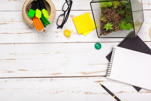 School supplies, stationery accessories on wood Premium Photo