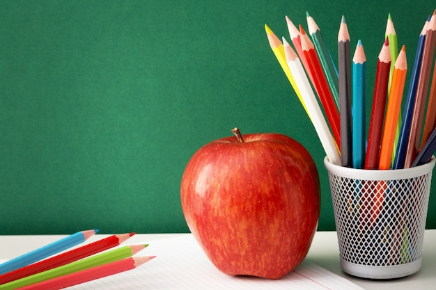 School Supplies With Blackboard Background Free Photo