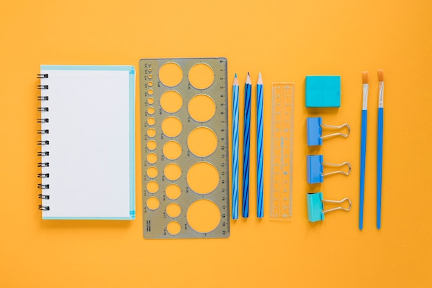 School supplies with blank notebook Free Photo