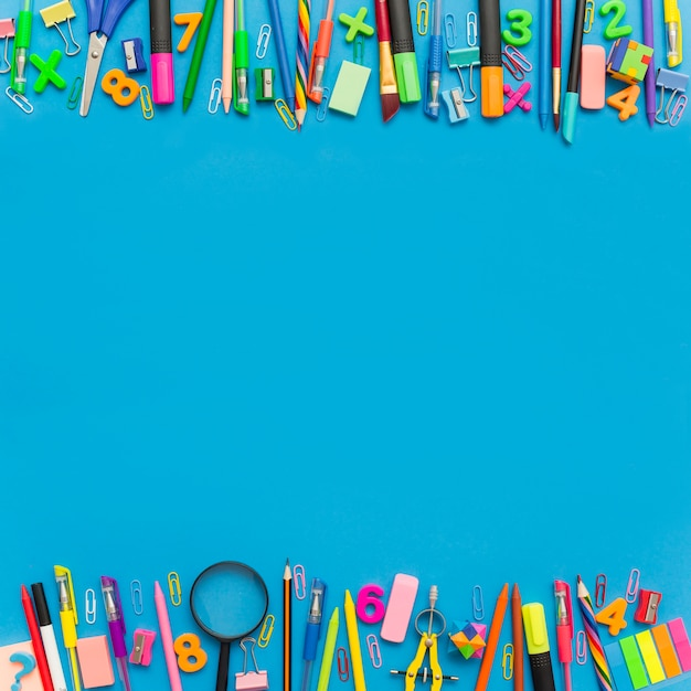 School supplies with copy space in middle. Free Photo