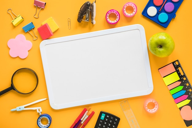 School supplies with whiteboard in center Free Photo