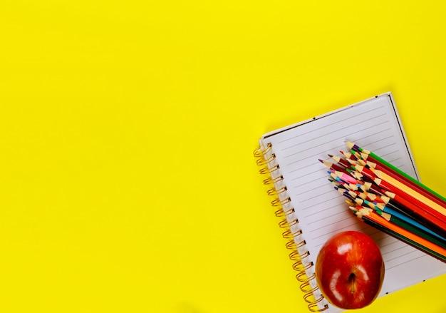 School supplies on yellow surface Premium Photo