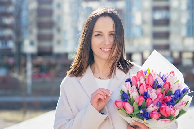 School teacher with flowers. farewell bell day of knowledge Premium Photo