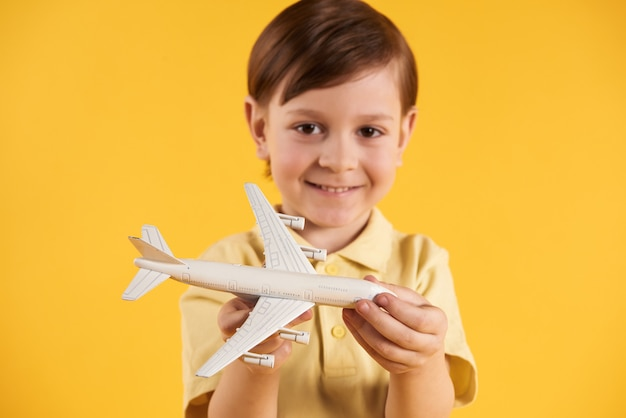 Schoolboy dreams of becoming pilot. childhood dreams. Premium Photo