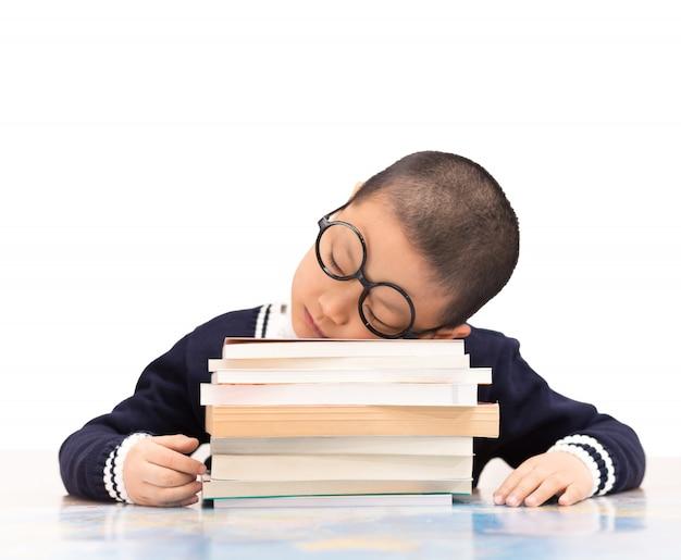 Schoolboy sleeping on school books Free Photo