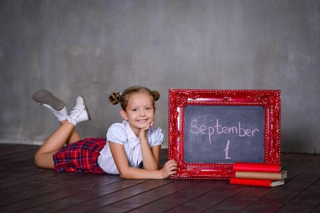 Schoolgirl with blackboard. school concept Premium Photo