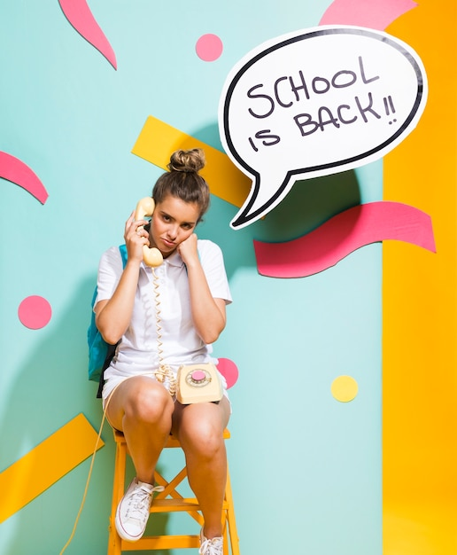 Schoolgirl with speech bubble template Free Photo