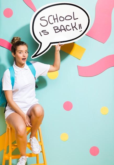Schoolgirl with speech bubble template Free Photo