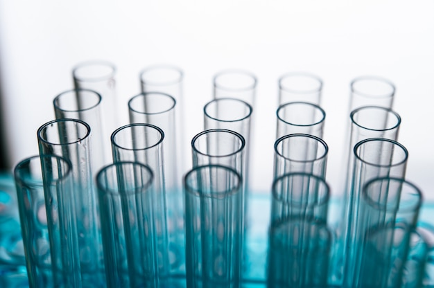 Science tubes arranged on the shelf Free Photo