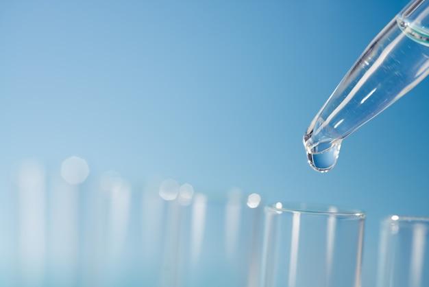 Scientific surface with laboratory glassware, text space Premium Photo
