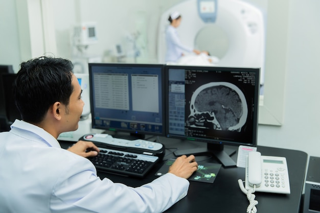 Scientist scanning the brains ct scan Premium Photo