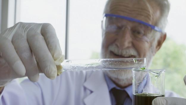 Scientist work with science equipment in laboratory. scientific research concept. Premium Photo