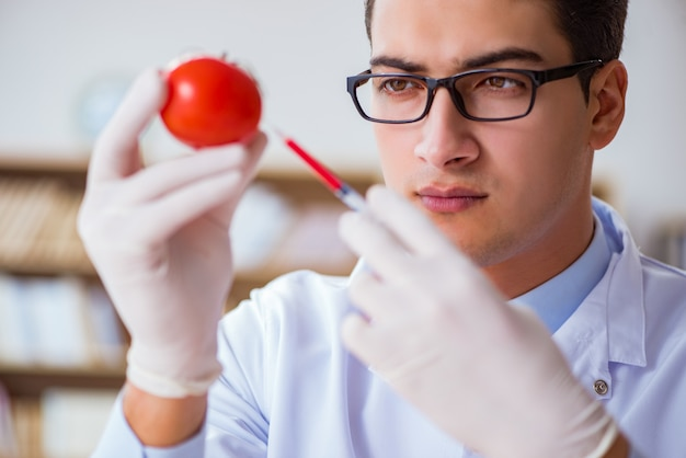 Scientist working on organic fruits and vegetables Premium Photo
