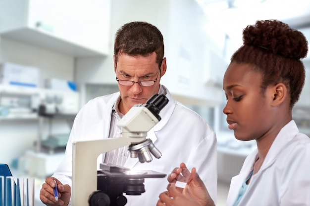 Scientists male and female, work in research facility Premium Photo