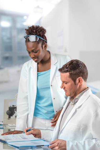 Scientists, male and female, work in research facility Premium Photo