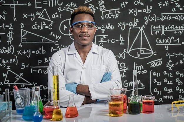 Scientists wear glasses and folded arms in the laboratory Free Photo