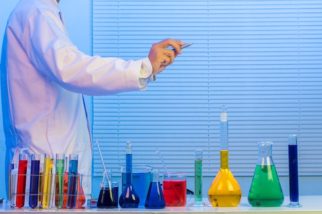 Scientists worker writing on glass whiteboard Premium Photo