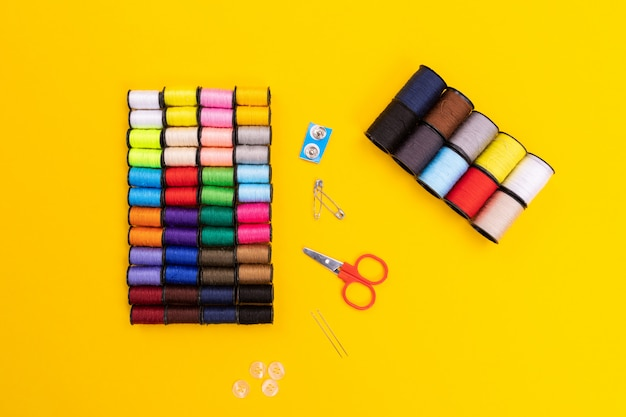 Scissors, buttons and pins isolated on a bright background Premium Photo
