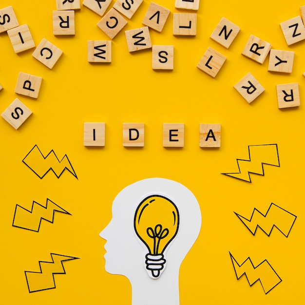 Scrabble letters and idea concept word with light bulb Premium Photo