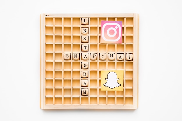 Scrabble wooden game showing instagram and snapchat words with their icons Free Photo