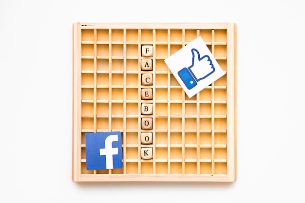 Scrabble wooden game with like symbol, facebook word and icon Free Photo