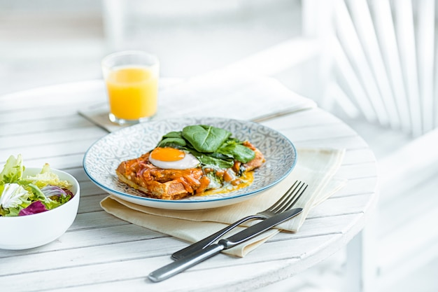 Scrambled eggs on meat with fried potatoes and toast Free Photo