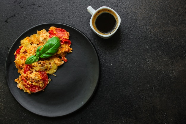 Scrambled eggs tomatoe, breakfast delicious and healthy, menu. food.  copyspace Premium Photo