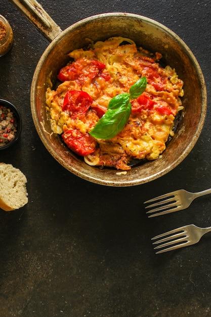 Scrambled eggs tomatoe, breakfast delicious and healthy, menu. food.  copyspace Premium Photo
