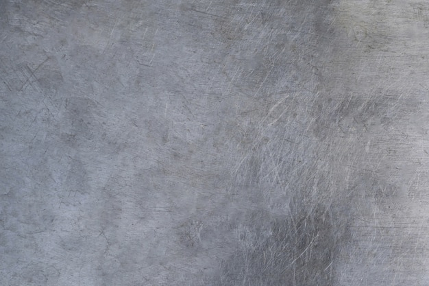 Scratched metal texture, brushed steel plate background Premium Photo