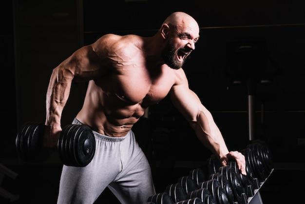 Screaming bald man lifting dumbbell 23 2147687629