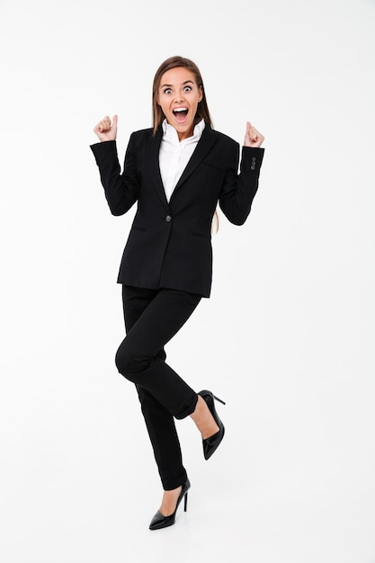 Screaming excited business woman standing isolated Free Photo