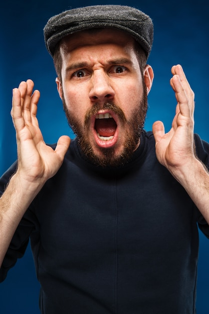 Screaming man with black sweater Free Photo