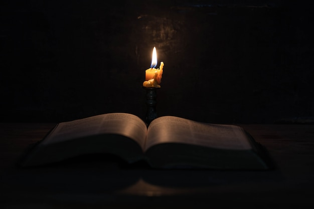 Scripture with candles Free Photo
