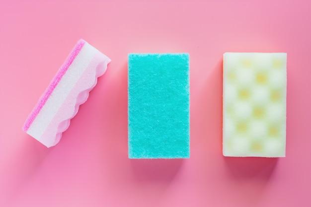 Scrub sponge on pink background Premium Photo
