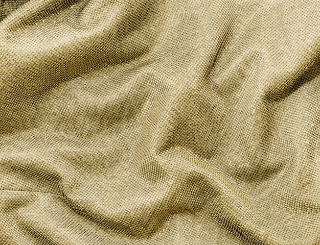 Scrunched gold fabric Free Photo