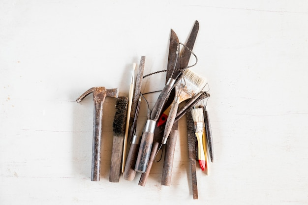 Sculpture tools. art and craft tools on white background. Premium Photo