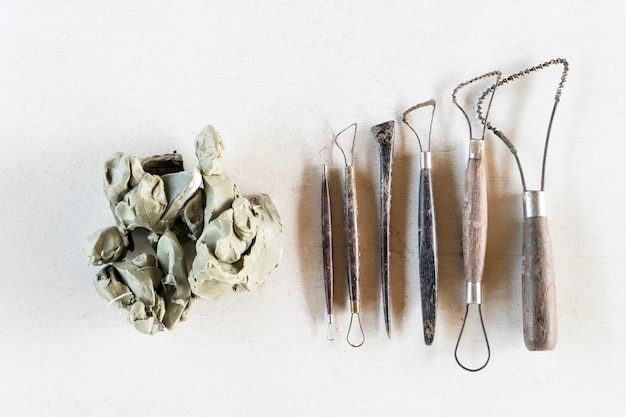 Sculpture tools set background. art and craft tools on a white background. Premium Photo