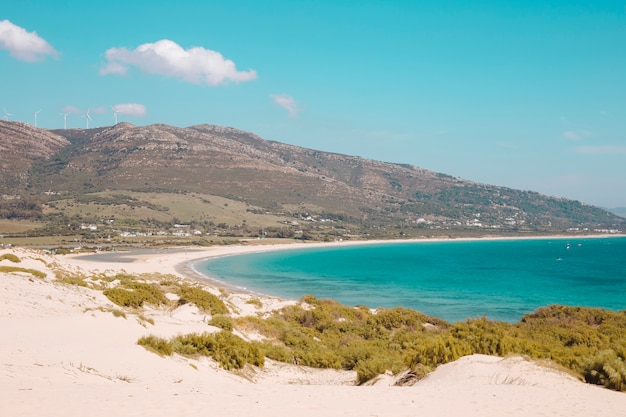 Sea coast with hills and blue sea Free Photo