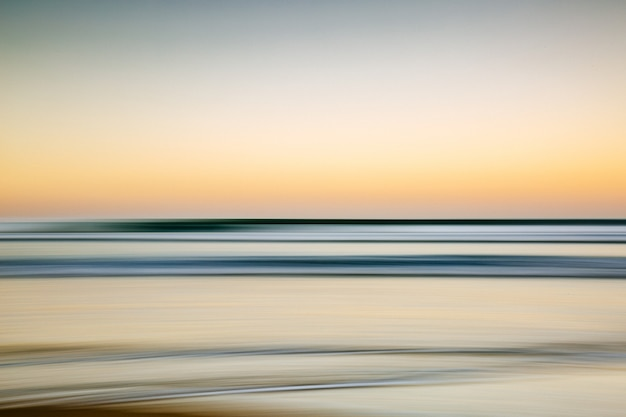 Sea during a colorful sunset with a motion effect - a cool picture for wallpapers and backgrounds Free Photo