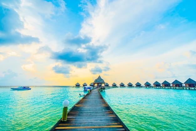 sea house resort exotic sky photo free download. Black Bedroom Furniture Sets. Home Design Ideas