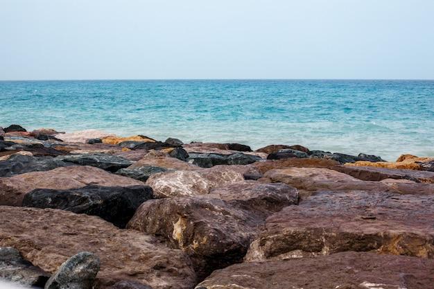 Sea landscape, rocks, sea and blue sky Premium Photo