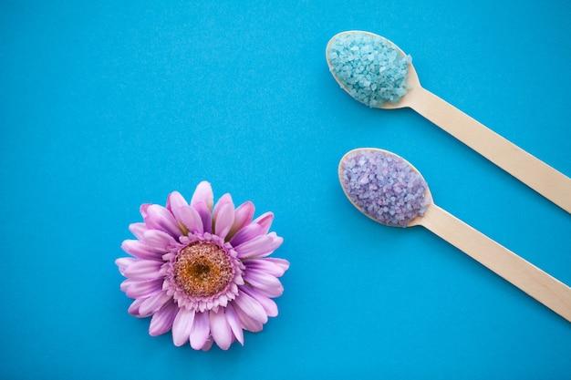Sea salt grind on wooden light blue shabby table wooden spoon, Premium Photo