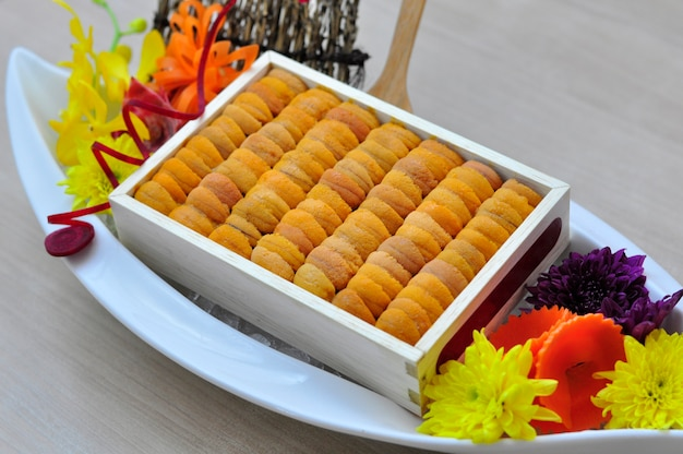 Sea Urchin Roe In Wooden Tray Japanese Style On White Plate