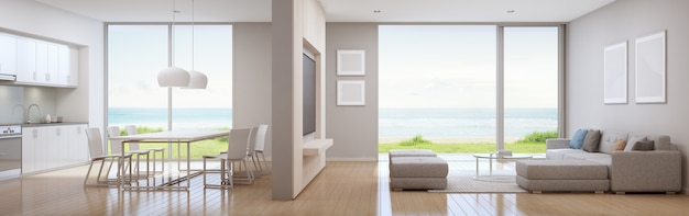 Sea view kitchen, dining and living room of luxury beach house in modern design.