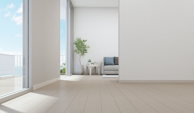Sea view living room of luxury beach house with indoor plant near glass door and wooden te Premium Photo