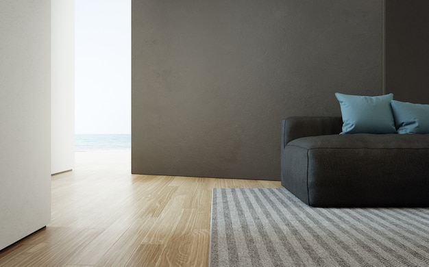 Sea view living room of luxury beach house with sofa on wooden floor. black concrete wall in vacation home or holiday villa. Premium Photo